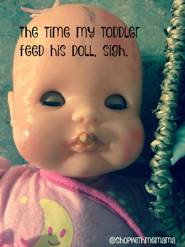 doll with food is her mouth