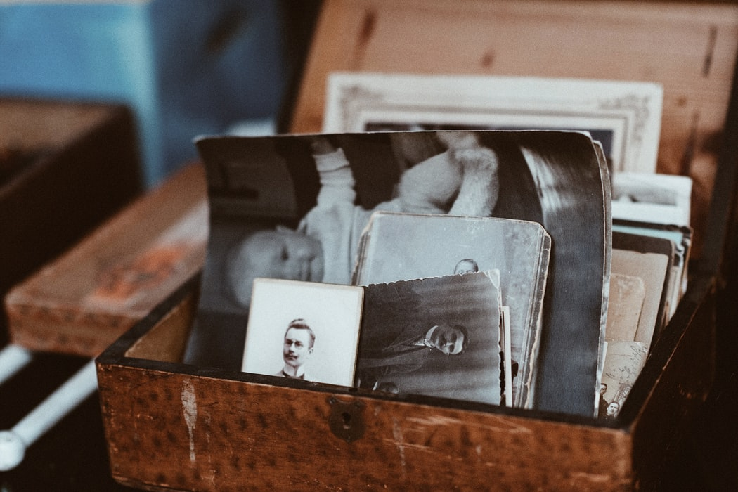 old pictures in a wooden box